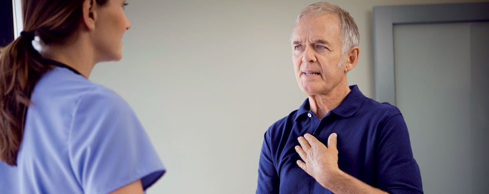 Man suffering with Dysphagia discussing options with Health care practitioner